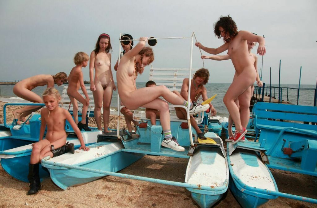 Family nudism, the sea, the sun and beach sand